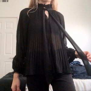 accordion high neck tie front blouse
